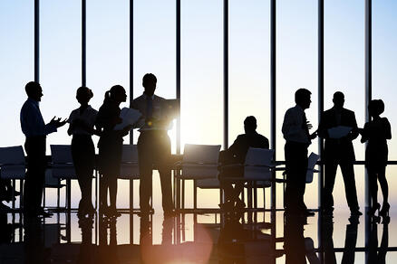 bigstock-Business-people-in-a-board-roo-215113246